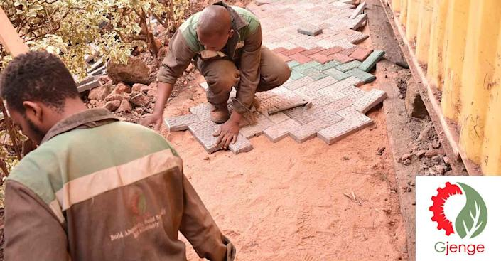 Matee's Gjenge Makers Ltd. team lays the finished bricks out in a Kenyan courtyard to create a patio area.