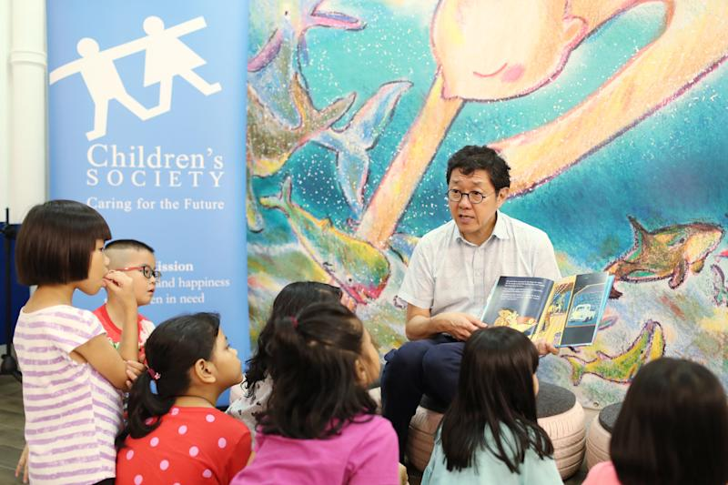 Eight beneficiaries from Student Care @ Children's Society, aged between seven and eight, at a reading of the story by author Goh Eck Kheng on 29 May, 2019. (PHOTO: SCS)