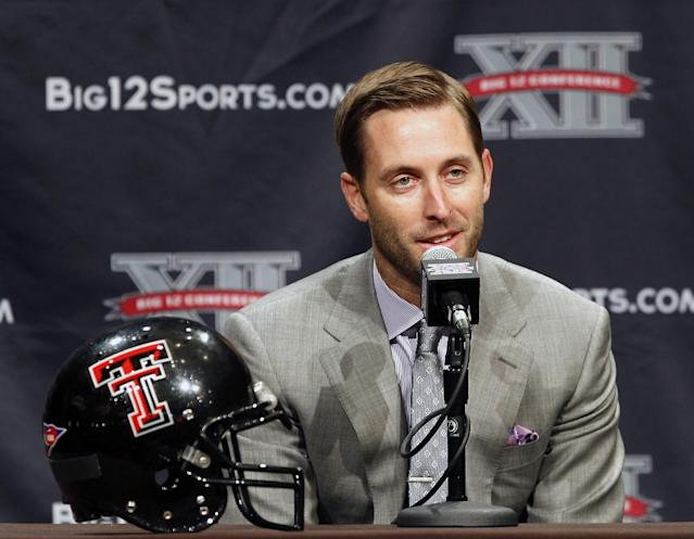 FILE - In this July 22, 2013 file photo, Texas Tech football coach Kliff Kingsbury answers questions from the media during the Big 12 Conference Football Media Days in Dallas. Texas Tech and first-year coach Kingsbury take on their first Big 12 opponent of the season. Last year's game in Fort Worth went to triple overtime before the Red Raiders (2-0) prevailed 56-53 over the Horned Frogs (1-1). (AP Photo/Tim Sharp, File)