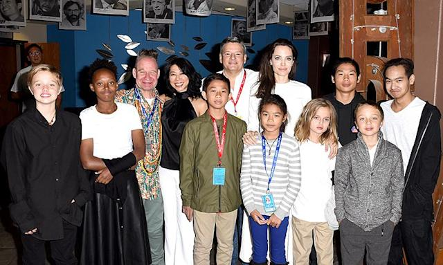 <p>If they look like red carpet naturals, it's because they have experience. Here they are — with mama Angie, Ung, and other behind-the-scenes peeps — at a screening of<em> First They Killed My Father</em> at the Telluride Film Festival 2017 on Sept. 2 (Photo: Vivien Killilea/Getty Images) </p>