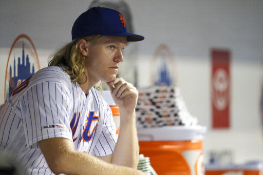 New York Mets starting pitcher Noah Syndergaard watches during the fourth inning of the team's baseball game against the Los Angeles Dodgers on Friday, Sept. 13, 2019, in New York. (AP Photo/Mary Altaffer)