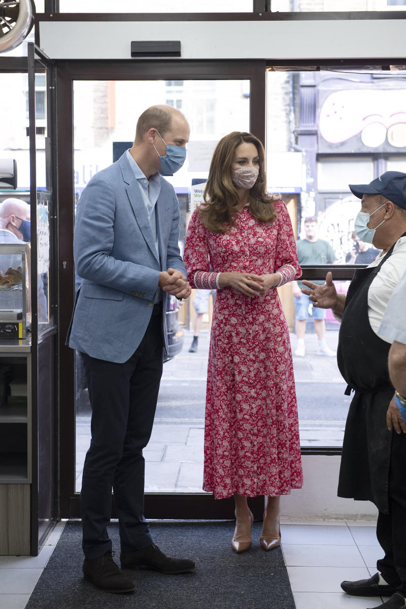 The Duchess of Cambridge wore the Calla Red Floral Shirt Dress from Beulah London as she visited the bakery in London. (Getty Images)