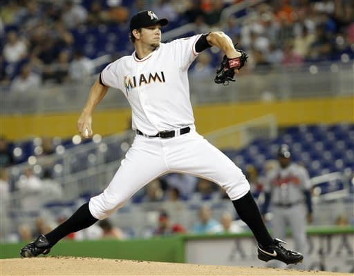 Miami Marlins' Josh Johnson pitches against the Atlanta Braves in the first inning of a baseball game in Miami, Wednesday, June 6, 2012. (AP Photo/Alan Diaz)