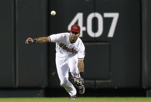 Arizona Diamondbacks' Chris Young can't catch a base hit by Miami Marlins' Donovan Solano during the third inning of a baseball game, the first of a doubleheader, Wednesday, Aug. 22, 2012, in Phoenix. (AP Photo/Matt York)