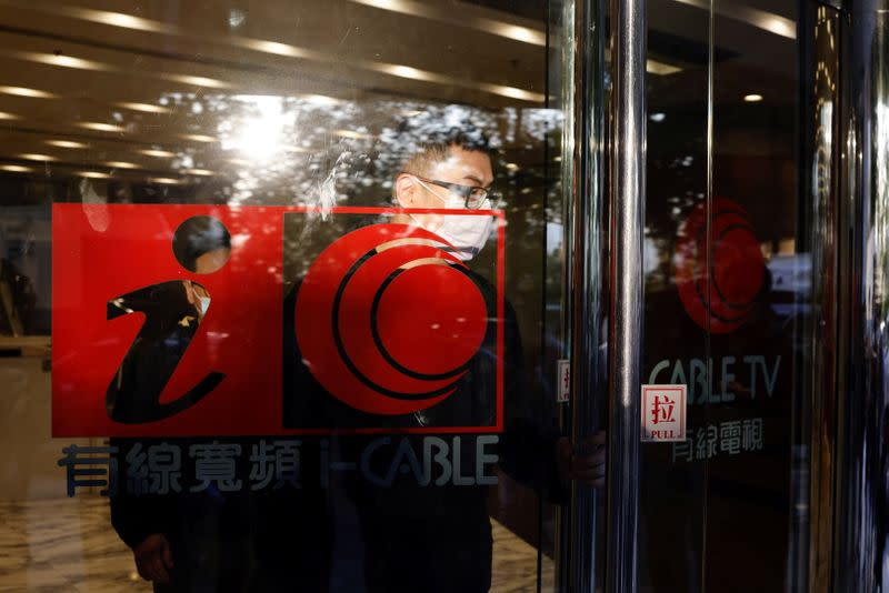 A man leaves i-Cable TV building after about 100 members of staff have been laid off in Hong Kong