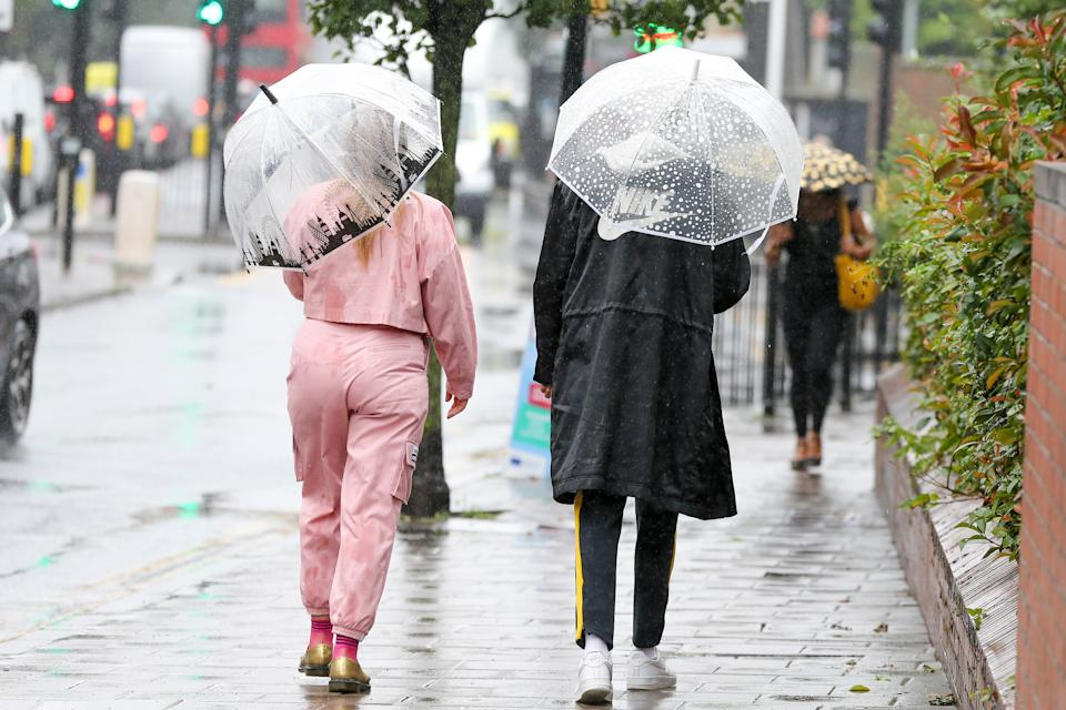People on the streets, shelter themselves from rain underneath umbrellas as Storm Ellen brings heavy rainfall with gusty winds in north London. According to the Met Office, warmer weather with highs of 24 degrees Celsius is forecasted for the rest of the week. (Photo by Dinendra Haria / SOPA Images/Sipa USA)