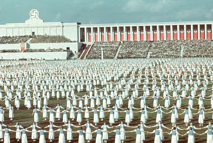 """League of German Girls dancing during the 1938 Reich Party Congress, Nuremberg, Germany. (Hugo Jaeger—Time & Life Pictures/Getty Images) <br> <br> <a href=""""http://life.time.com/world-war-ii/nazi-propaganda-and-the-myth-of-aryan-invincibility/#1"""" rel=""""nofollow noopener"""" target=""""_blank"""" data-ylk=""""slk:Click here to see the full collection at LIFE.com"""" class=""""link rapid-noclick-resp"""">Click here to see the full collection at LIFE.com</a>"""