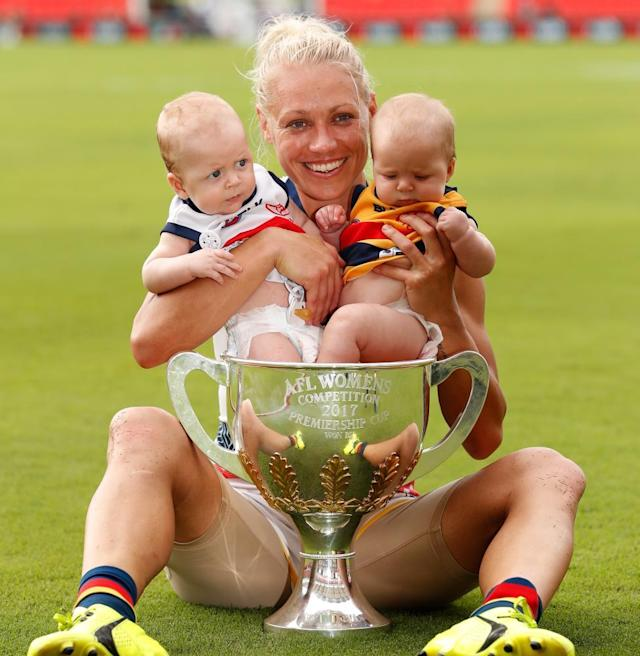 "<span class=""element-image__caption"">Erin Phillips of the Crows celebrates Adelaide's AFLW grand final victory with her children Blake and Brooklyn.</span> <span class=""element-image__credit"">Photograph: Michael Willson/AFL Media/Getty Images</span>"