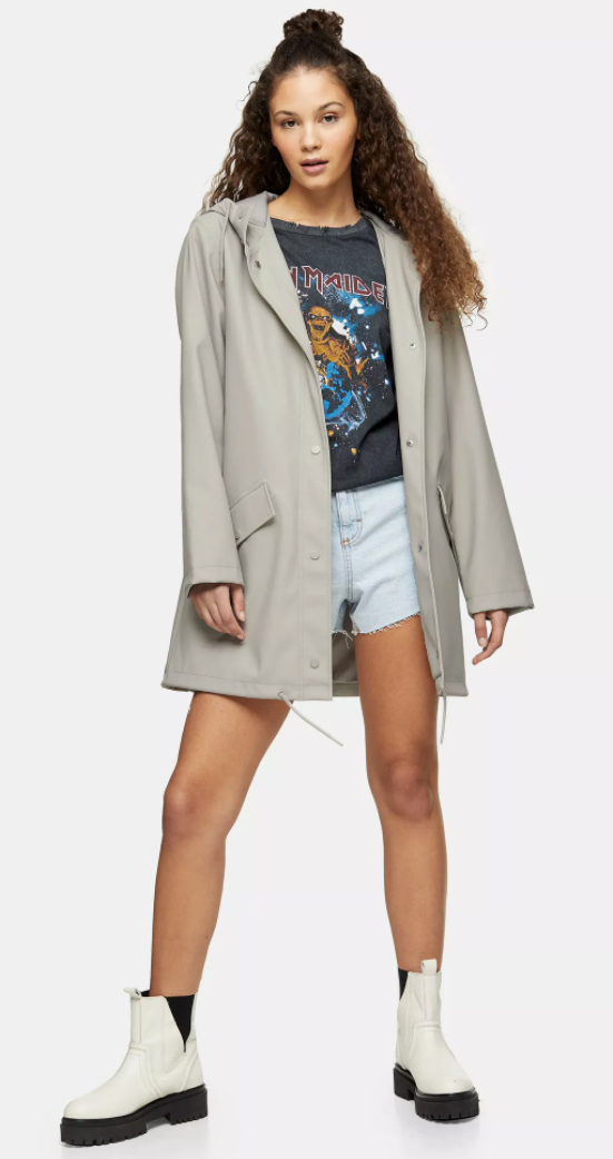 """<p><strong>Top Shop</strong></p><p>topshop.com</p><p><strong>$95.00</strong></p><p><a href=""""https://go.redirectingat.com?id=74968X1596630&url=https%3A%2F%2Fus.topshop.com%2Fen%2Ftsus%2Fproduct%2Fgrey-rain-mac-9757823&sref=https%3A%2F%2Fwww.goodhousekeeping.com%2Fbeauty%2Ffashion%2Fg32585880%2Frainy-day-outfits%2F"""" rel=""""nofollow noopener"""" target=""""_blank"""" data-ylk=""""slk:Shop Now"""" class=""""link rapid-noclick-resp"""">Shop Now</a></p><p>A hooded Mac raincoat lends a classic shape <em>and</em> protection from the elements. The neutral color pairs well with any outfit so you don't have to worry about matching. </p>"""