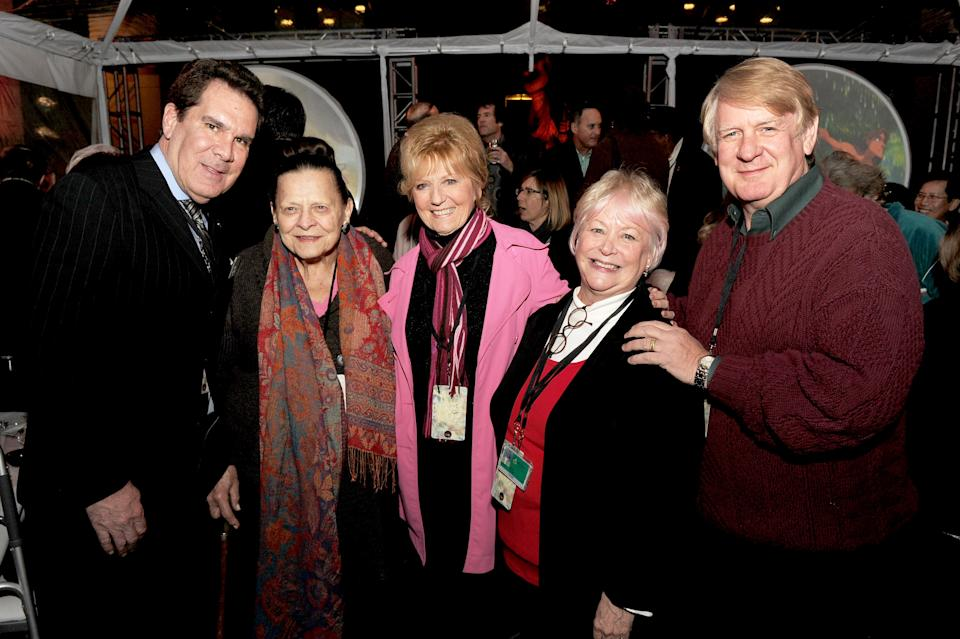 """BURBANK, CA - DECEMBER 10:  (L-R)  Animator/voice actor Tony Anselmo, """"Donald Duck"""", stylist Alice Davis, voice actress Kathryn Beaumont, """"Alice"""" and """"Wendy"""", voice actress Russi Taylor, """"Minnie Mouse"""" and voice actor Bill Farmer, """"Goofy"""" and """"Pluto"""" pose at a reception to celebrate 90 Years of Disney animation at The Walt Disney Studios on December 10, 2013 in Burbank, California.  (Photo by Kevin Winter/Getty Images)"""