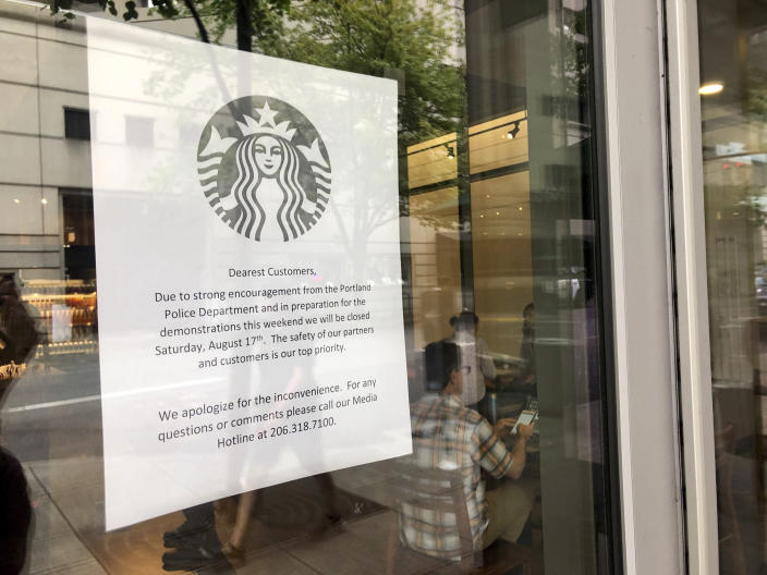 A coming closure sign is posted in the window of a Starbucks Cafe near where a large rally is planned in Portland, Ore., Friday, Aug. 16, 2019. In the past week, authorities in Portland have arrested a half-dozen members of right-wing groups on charges related to violence at previous politically motivated rallies as the liberal city braces for potential clashes between far-right groups and self-described anti-fascists who violently oppose them. (AP Photo/Gillian Flaccus)
