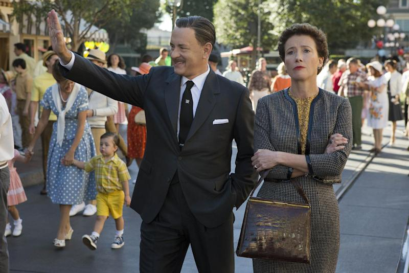 """This undated photo released by Disney shows Tom Hanks, left, as Walt Disney showing Disneyland to Emma Thompson as """"Mary Poppins"""" author P.L. Travers, in Disney's """"Saving Mr. Banks,"""" releasing in U.S. theaters limited on December 13, 2013 and wide on December 20, 2013. Disney is previewing several of the studio's upcoming live-action films for fans at the D23 Expo, Aug. 9-11, 2013, a three-day Disney extravaganza at the Anaheim Convention Center. """"Thor: The Dark World,"""" """"Captain America: Winter Soldier,"""" """"Muppets Most Wanted,"""" """"Saving Mr. Banks"""" and """"Tomorrowland"""" are just some of the movies that will be teased at a Saturday morning presentation. (AP Photo/Copyright Disney Enterprises, Inc., François Duhamel)"""