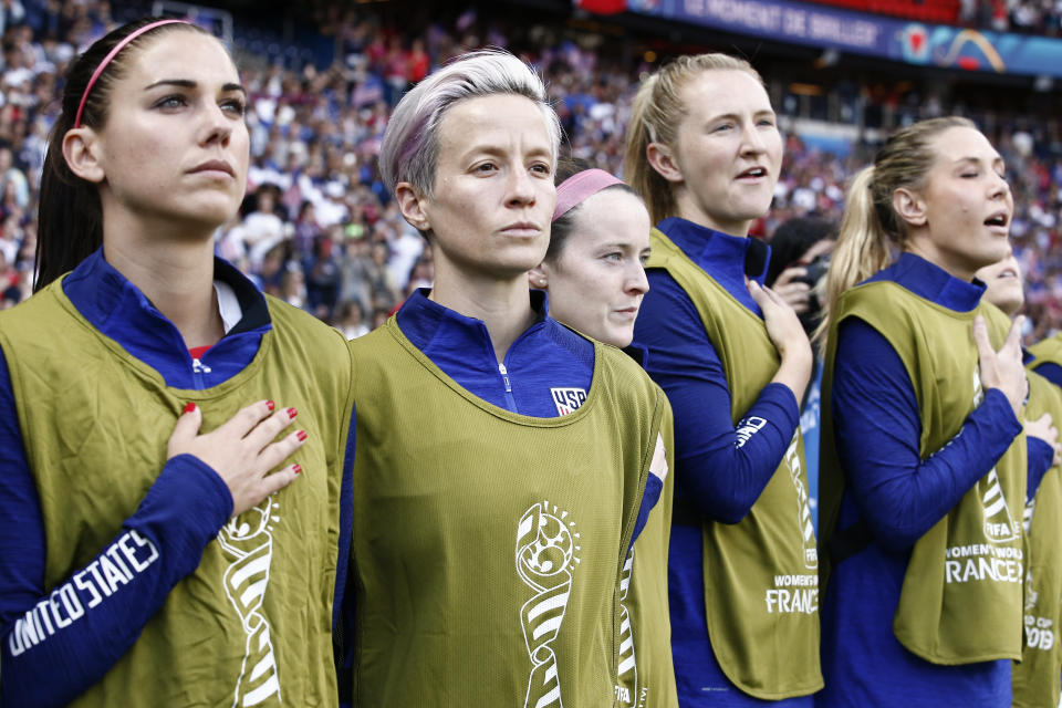 PARIS, FRANCE - JUNE 16: Megan Rapinoe #15 of USA (center) and her teammates are standing for the national anthem during the 2019 FIFA Women's World Cup France group F match between USA and Chile at Parc des Princes on June 16, 2019 in Paris, France. (Photo by Catherine Steenkeste/Getty Images)