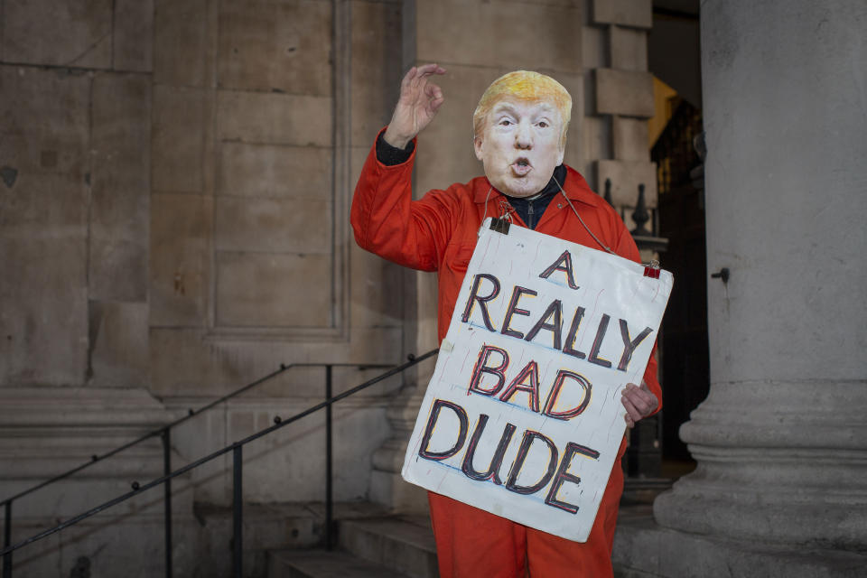 A man wearing an orange prison outfit and a Donald Trump mask during a protest against U.S. President Donald Trump UK visit to attend the NATO (North Atlantic Treaty Organisation) summit on the 3rd December 2019 in London in the United Kingdom. Ahead of a British national election on 12th December 2019, Stop Trump Coalition and CND, (Campaign for Nuclear Disarmament) organised a protest to target a banquet at Buckingham Palace where Trump will dine with the Queen and other NATO leaders. The U.K. is hosting NATO summit to mark the military alliance's 70th anniversary. (photo by Sam Mellish / In Pictures via Getty Images)