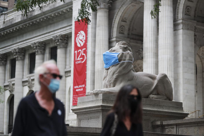 A marble lion is seen with a face mask in front of the New York Public Library on the Fifth Avenue in New York, the United States, July 8, 2020. (Wang Ying/Xinhua via Getty)