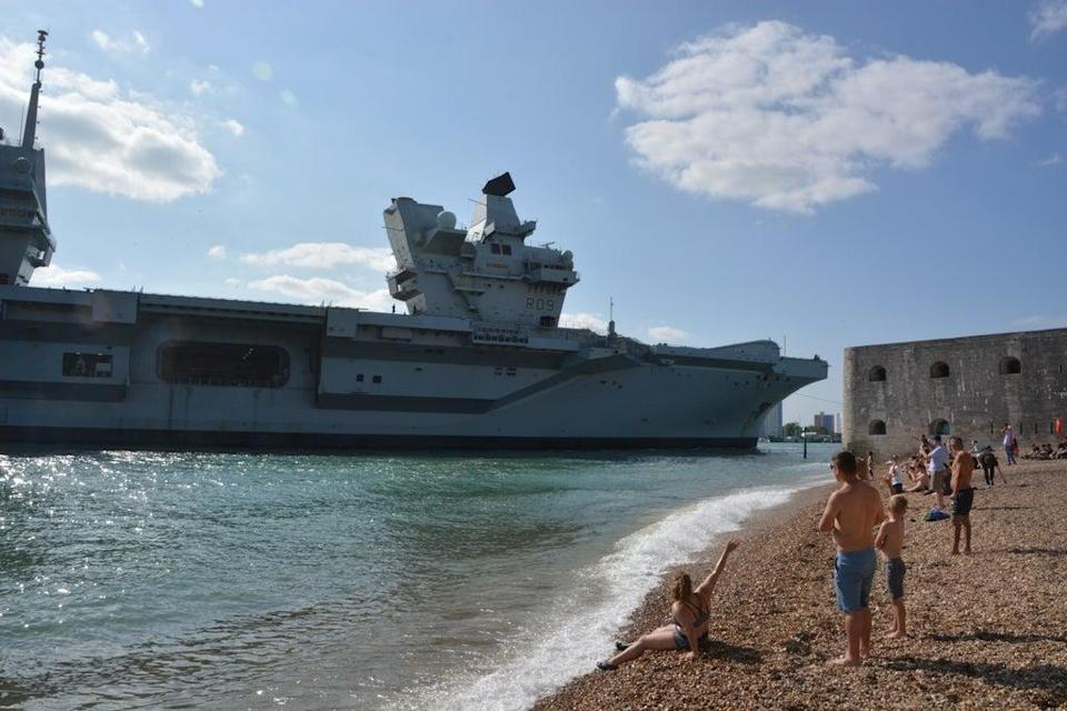Sunbathers welcome HMS Prince of Wales back to Portsmouth (Ben Mitchell/PA) (PA Wire)