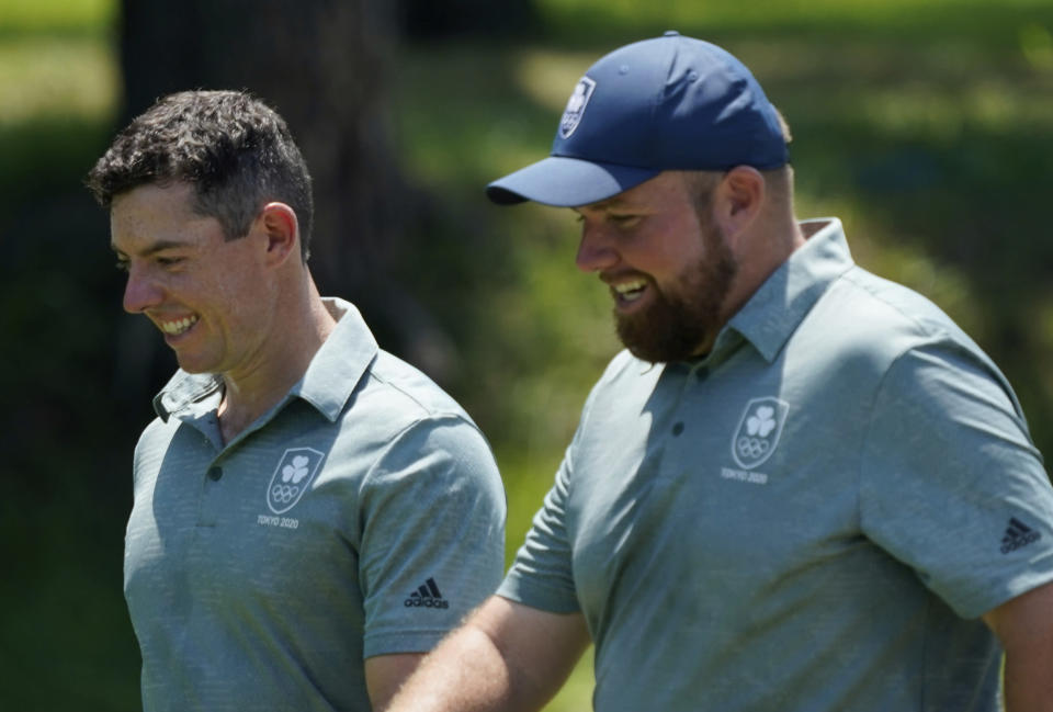 Ireland's Rory McIlroy and his teammate Shane Lowry speak during a practice round of the men's golf event at the 2020 Summer Olympics, Tuesday, July 27, 2021, at the Kasumigaseki Country Club in Kawagoe, Japan, (AP Photo/Matt York)