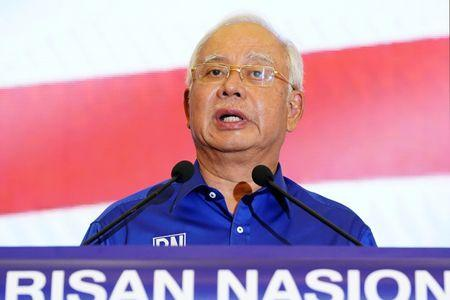 Former Malaysian PM Najib resigns as party chief, barred from leaving country
