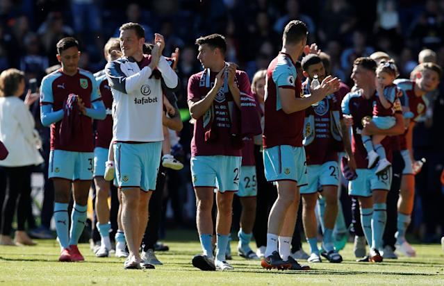 "Soccer Football - Premier League - Burnley vs AFC Bournemouth - Turf Moor, Burnley, Britain - May 13, 2018 Burnley's Chris Wood and Matthew Lowton applaud their fans during a lap of honour after the match REUTERS/Andrew Yates EDITORIAL USE ONLY. No use with unauthorized audio, video, data, fixture lists, club/league logos or ""live"" services. Online in-match use limited to 75 images, no video emulation. No use in betting, games or single club/league/player publications. Please contact your account representative for further details."