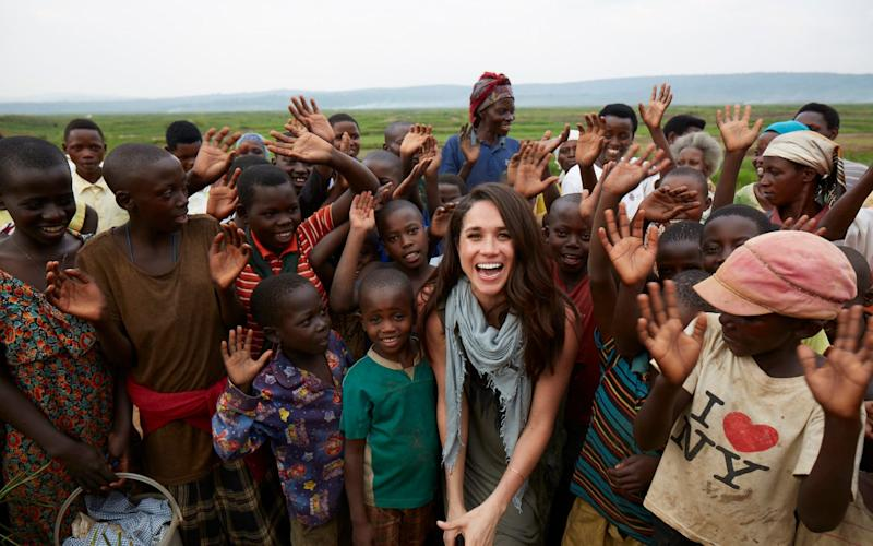 Meghan in Rwanda with charity World Vision in 2017 - PA