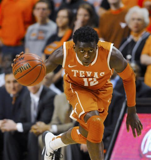 Texas guard Myck Kabongo looks up the court after stealing the ball from Oklahoma State during the first half of an NCAA basketball game in Stillwater, Okla., Saturday, March 2, 2013. Oklahoma State won 78-65. (AP Photo/Brody Schmidt)