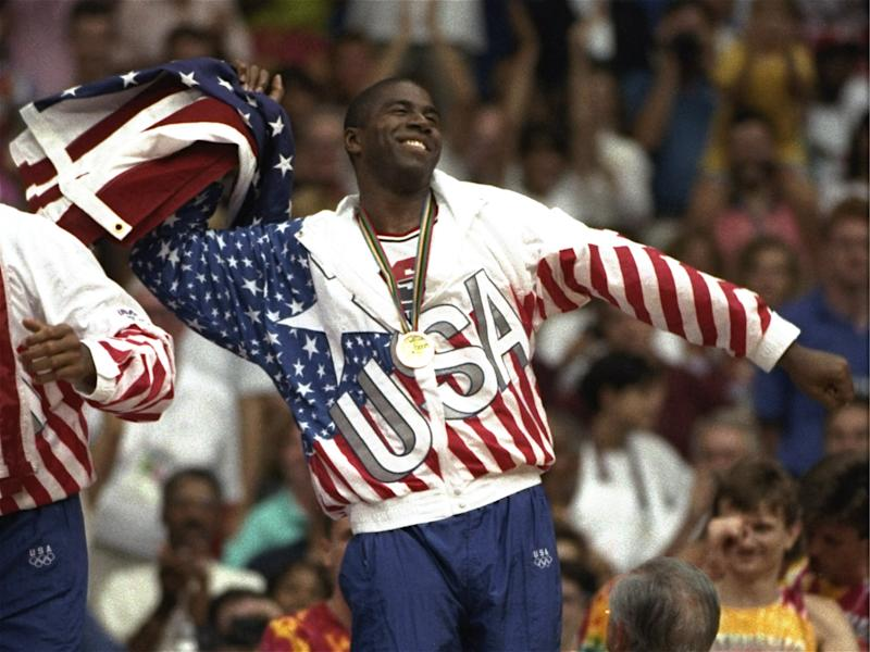 "USA's Earvin ""Magic"" Johnson whips the United States flag in ecstasy during the gold medal ceremony Saturday, August 8, 1992, during the 1992 Summer Olympic games in Barcelona. (AP Photo/ Susan Ragan)"