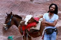 A Jordanian donkey owner waits for customers at Petra, where many workers have struggled to earn an income after tourist numbers dried up amid the coronavirus pandemic