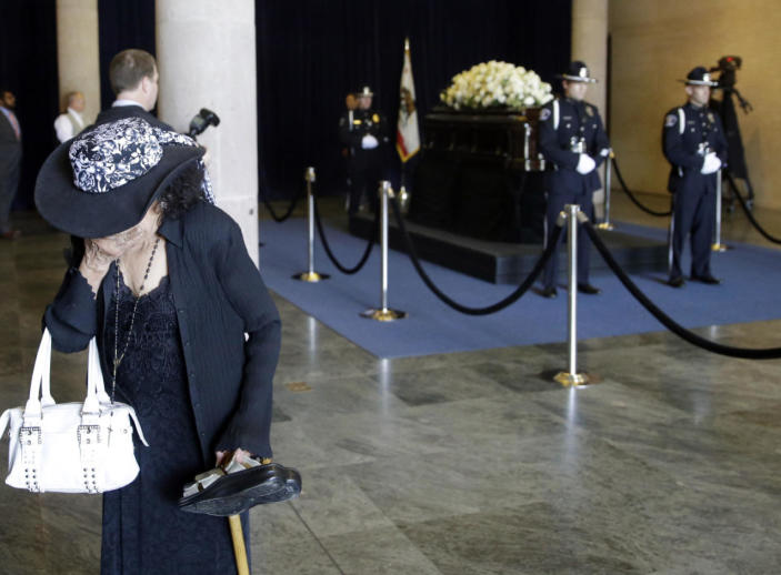 <p>A woman cries after viewing the casket of Nancy Reagan on Thursday at the Ronald Reagan Presidential Library in Simi Valley, Calif. <i> (Photo: Jae C. Hong/ Pool/AP)</i></p>
