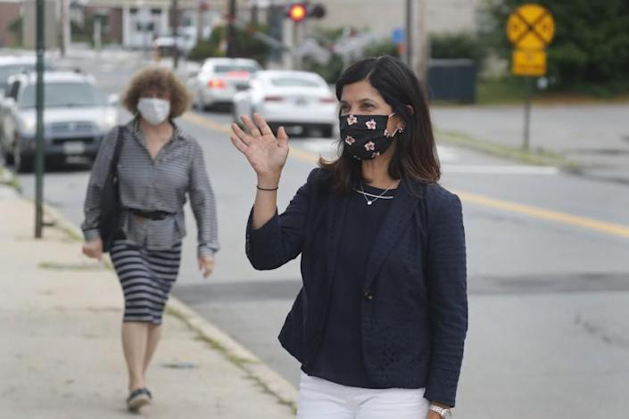 """Democratic Senate candidate Sara Gideon greets voters on primary day Tuesday in Portland, Maine, before winning the right to challenge longtime GOP Sen. Susan Collins. <span class=""""copyright"""">(Elise Amendola / Associated Press)</span>"""