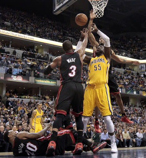 Indiana Pacers center Roy Hibbert (55) goes for a rebound against Miami Heat guard Dwyane Wade (3) during the second half of an NBA basketball game in Indianapolis, Wednesday, March 26, 2014. The Pacers won 84-83. (AP Photo/AJ Mast)