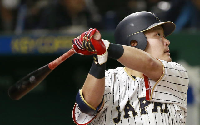 FILE - In this March 15, 2017, file photo, Japan's Yoshitomo Tsutsugo watches the flight of his solo home-run off Israel's pitcher Dylan Axelrod in the sixth inning of their second round game at the World Baseball Classic at Tokyo Dome in Tokyo. The Tampa Bay Rays are working to finalize a two-year contract worth about $12 million with Japanese slugger Tsutsugo, a person familiar with the negotiations told The Associated Press. The person spoke on condition of anonymity Friday, Dec. 13, 2019, because the agreement had not been announced. (AP Photo/Shizuo Kambayashi, File)