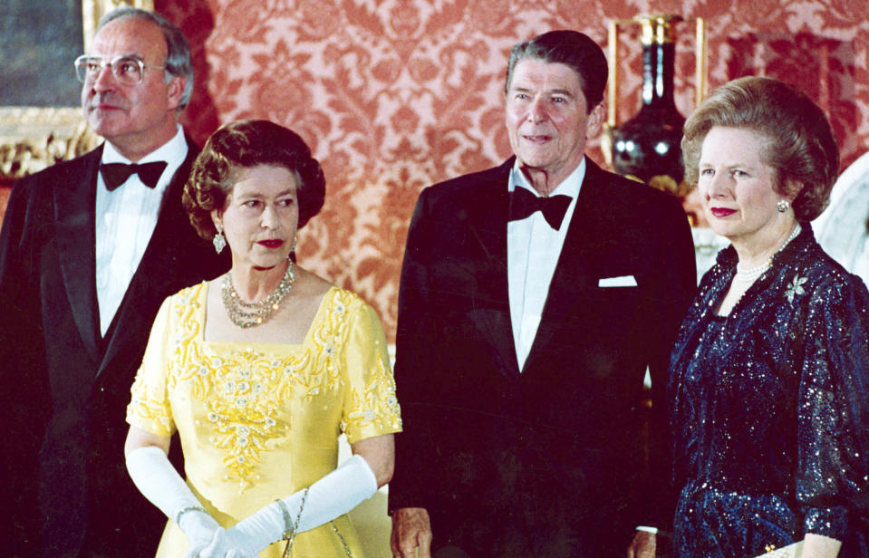 FILE - The June 10, 1984 file photo shows Queen Elizabeth II, second left, standing with, West German Chancellor Helmut Kohl, left, U.S. President Ronald Reagan, second right, and Britain's Prime Minister Margaret Thatcher at London's Buckingham Palace, prior to a dinner for summit leaders. (AP Photo, File)
