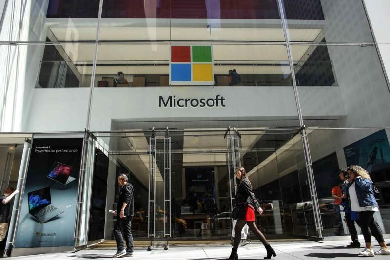 People walk outside the Microsoft store on Fifth Avenue in New York City on April 26, 2018 in New York.
