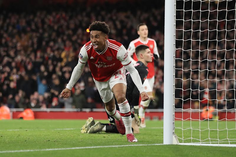 LONDON, ENGLAND - JANUARY 06: Reiss Nelson of Arsenal celebrates scoring the opening goal during the FA Cup Third Round match between Arsenal and Leeds United at Emirates Stadium on January 6, 2020 in London, England. (Photo by Marc Atkins/Getty Images)