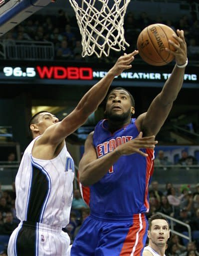 Detroit Pistons' Andre Drummond, right, makes a shot despite defensive effort by Orlando Magic's Gustavo Ayon, left, of Mexico, during the first half of an NBA basketball game, Wednesday, Nov. 21, 2012, in Orlando, Fla. (AP Photo/John Raoux)
