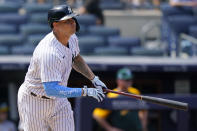 New York Yankees' Gary Sanchez reacts after hitting a two-run double during the sixth inning of a baseball game against the Oakland Athletics, Sunday, June 20, 2021, at Yankee Stadium in New York. (AP Photo/Kathy Willens)