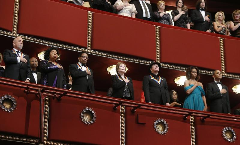 REFILE - CORRECTING SPELLING OF SHIRLEY'S LAST NAME  Billy Joel (from L) and fellow 2013 Kennedy Center Honors recipients Martina Arroyo, Herbie Hancock, Shirley MacLaine and Carlos Santana stand for the national anthem with U.S. President Barack Obama (R) and first lady Michelle Obama (2nd R) at the Kennedy Center in Washington December 8, 2013. REUTERS/Jonathan Ernst (UNITED STATES - Tags: POLITICS ENTERTAINMENT)