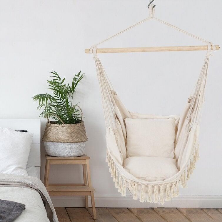 """<h2>Best Hammock Chair</h2><br><h3>Dakota Fields Vandyke Chair Hammock<br></h3><br><strong>The Hype:</strong> 4.5 out of 5 stars and 51reviews<br><br><strong>Reviewers say:</strong> """"I hung this from my oak tree and just love it. It is comfortable with or without using the pillows it comes with. I leave it out even when it rains because it dries quickly in the breeze...The only problem is that my two small dogs like it too and jump in every time I sit in it.""""<br><br><em>Shop</em> <strong><em><a href=""""https://www.wayfair.com/brand/bnd/dakota-fields-b55650.html"""" rel=""""nofollow noopener"""" target=""""_blank"""" data-ylk=""""slk:Dakota Fields"""" class=""""link rapid-noclick-resp"""">Dakota Fields</a></em></strong><br><br><br><strong>Dakota Fields</strong> Vandyke Chair Hammock, $, available at <a href=""""https://go.skimresources.com/?id=30283X879131&url=https%3A%2F%2Fwww.wayfair.com%2Foutdoor%2Fpdp%2Fdakota-fields-vandyke-chair-hammock-w003404468.html"""" rel=""""nofollow noopener"""" target=""""_blank"""" data-ylk=""""slk:Wayfair"""" class=""""link rapid-noclick-resp"""">Wayfair</a>"""