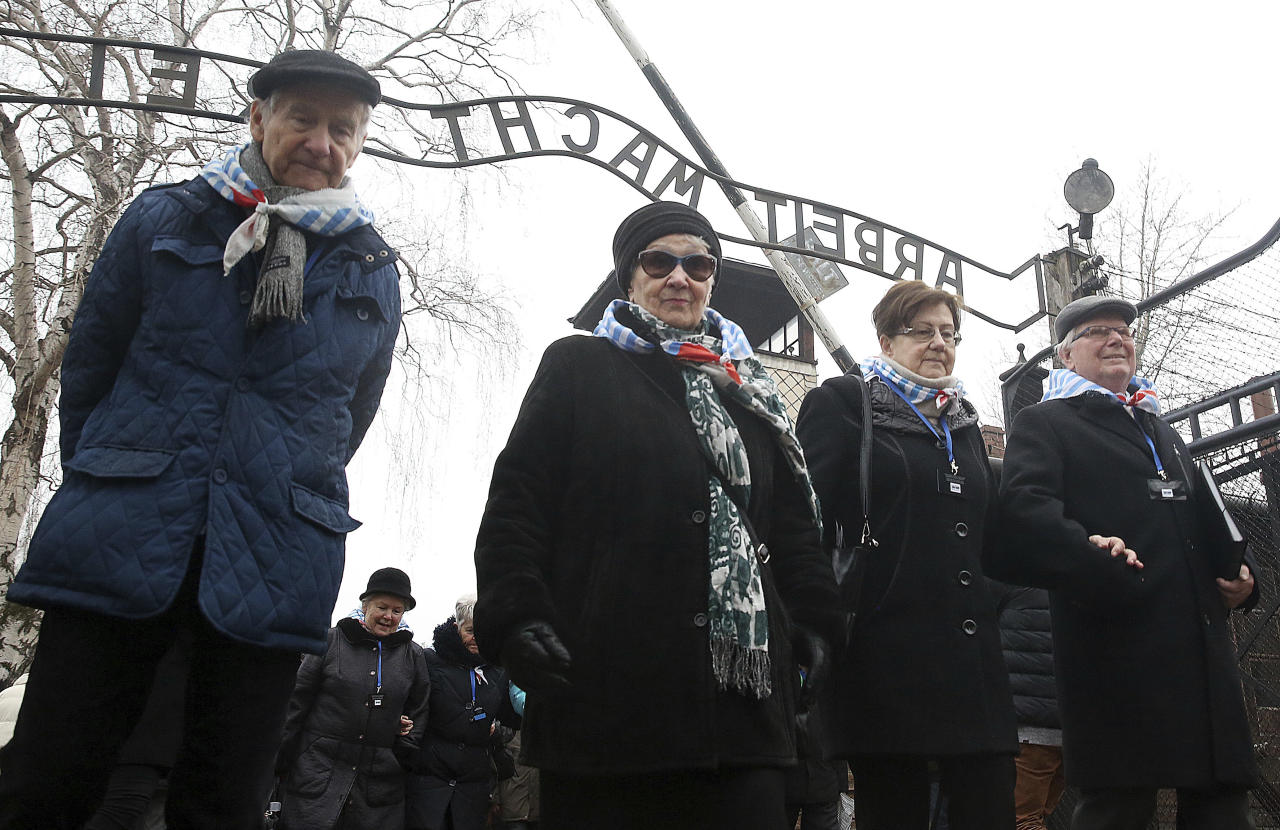 "<p>Survivors and guests walk past the ""Arbeit Macht Frei"" gate at the former Nazi German concentration camp on International Holocaust Remembrance Day in Oswiecim, Poland, Saturday, Jan. 27, 2018. (Photo: Czarek Sokolowski/AP) </p>"