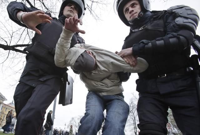 <p>Russian police detain a protester at a demonstration against President Vladimir Putin in St.Petersburg, Russia, Saturday, May 5, 2018. (Photo: Dmitri Lovetsky/AP) </p>