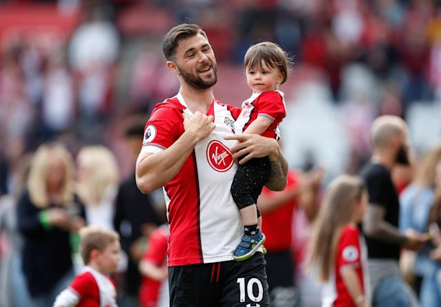 "Soccer Football - Premier League - Southampton vs Manchester City - St Mary's Stadium, Southampton, Britain - May 13, 2018 Southampton's Charlie Austin during a lap of appreciation after the match Action Images via Reuters/John Sibley EDITORIAL USE ONLY. No use with unauthorized audio, video, data, fixture lists, club/league logos or ""live"" services. Online in-match use limited to 75 images, no video emulation. No use in betting, games or single club/league/player publications. Please contact your account representative for further details."