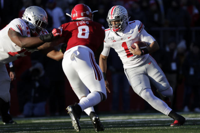 Ohio State quarterback Justin Fields (1) rushes against Rutgers linebacker Tyshon Fogg (8) during the first half of an NCAA college football game Saturday, Nov. 16, 2019, in Piscataway, N.J. (AP Photo/Adam Hunger)