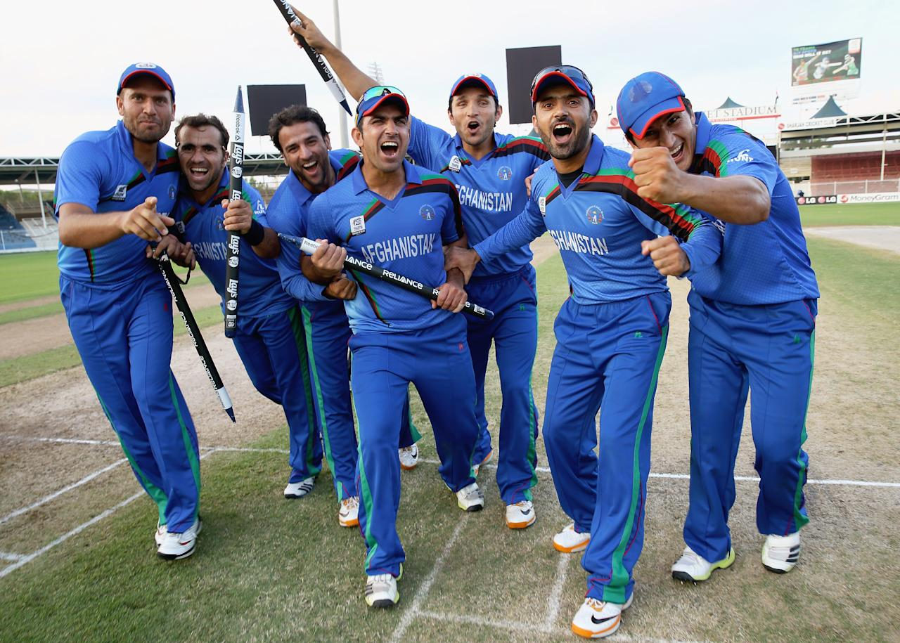DUBAI, UNITED ARAB EMIRATES - NOVEMBER 24:  Afghanistan players celebrate their win over Kenya after the ICC World Twenty20 Qualifier between Afghanistan and Kenya at Sharjah Cricket Stadium on November 24, 2013 in Dubai, United Arab Emirates.  (Photo by Matthew Lewis-IDI/IDI via Getty Images)