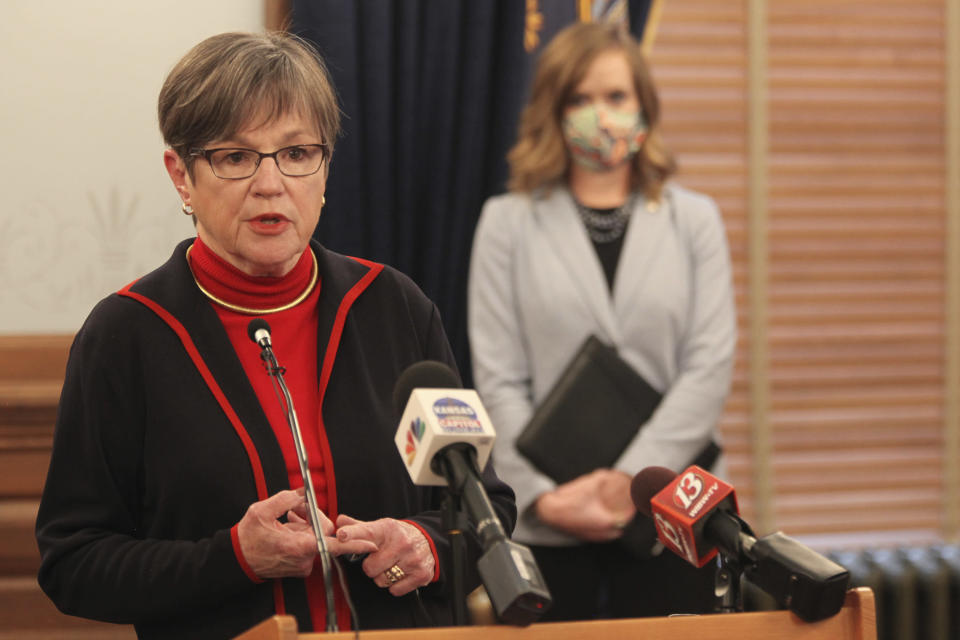 """Kansas Gov. Laura Kelly discusses a proposal she outlined for cutting state income taxes during a news conference, Tuesday, Feb. 9, 2021, at the Statehouse in Topeka, Kan. The Democratic governor's proposal is an alternative to a Republican that she calls """"particularly irresponsible"""" during the COVID-19 pandemic. (AP Photo/John Hanna)"""