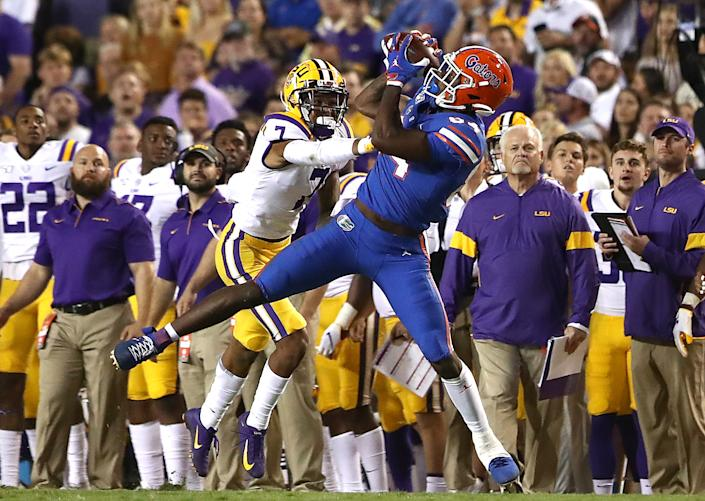 BATON ROUGE, LOUISIANA - OCTOBER 12: Kyle Pitts #84 of the Florida Gators catches a pass as Grant Delpit #7 of the LSU Tigers defends at Tiger Stadium on October 12, 2019 in Baton Rouge, Louisiana. (Photo by Marianna Massey/Getty Images)