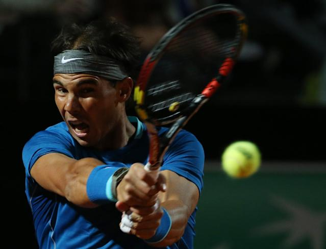Spain's Rafael Nadal returns a backhand to Britain's Andy Murray during their match at the Italian open tennis tournament in Rome, Friday, May 16, 2014. (AP Photo/Gregorio Borgia)