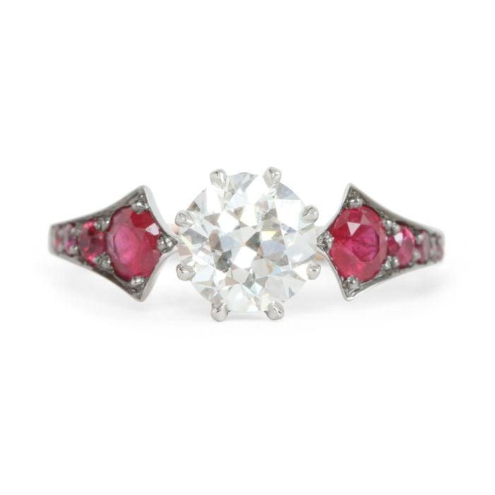 """<p>The <a href=""""https://www.popsugar.com/buy/Ruby-Wings-Ring-532659?p_name=Ruby%20Wings%20Ring&retailer=catbirdnyc.com&pid=532659&price=12%2C900&evar1=fab%3Aus&evar9=47015200&evar98=https%3A%2F%2Fwww.popsugar.com%2Ffashion%2Fphoto-gallery%2F47015200%2Fimage%2F47025522%2FBig-Round-Ruby-Wings-Ring&list1=shopping%2Cjewelry%2Crings%2Cengagement%20rings&prop13=mobile&pdata=1"""" rel=""""nofollow noopener"""" class=""""link rapid-noclick-resp"""" target=""""_blank"""" data-ylk=""""slk:Ruby Wings Ring"""">Ruby Wings Ring</a> ($12,900) gives the circular diamond room to shine by highlighting it with enchanting red rubies on either side.</p>"""