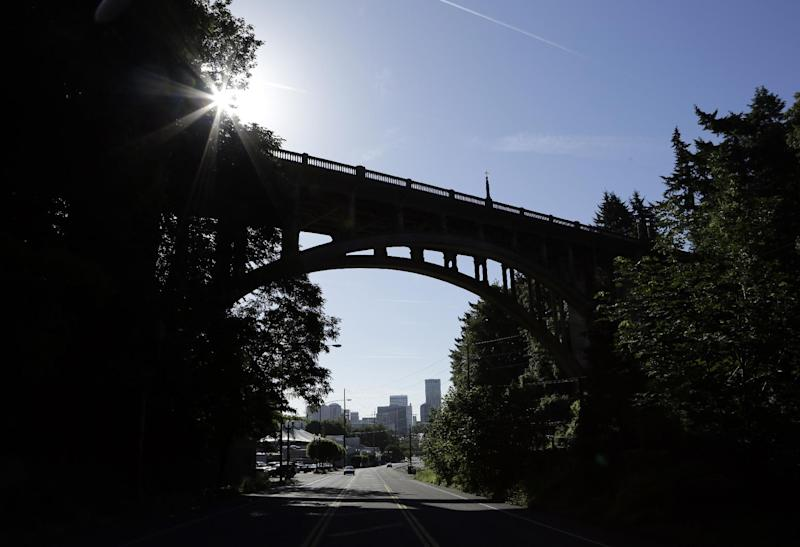 "In this Tuesday, June 4, 2013, photo, downtown is visible under under the Vista Bridge, historically known as ""The Suicide Bridge"" , in the Goose Hollow neighborhood west of downtown Portland, Ore. The numbers vary annually, but a suicide or two occurs each year at the arch bridge from which there is a majestic vista of the city skyline. Now a group called Friends of the Vista Bridge is pressing the city to install suicide-prevention barriers, a step taken at bridges throughout the world where suicides have become prevalent. (AP Photo/Don Ryan)"