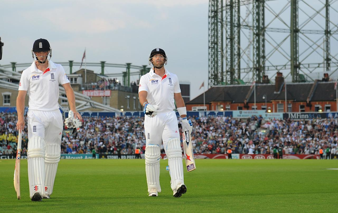 England's Chris Woakes and Matt Prior walk off after bad light stops play during day five of the Fifth Investec Ashes Test match at The Kia Oval, London.