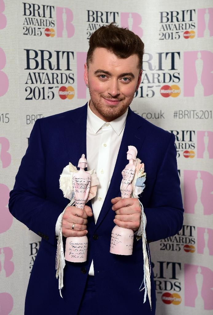 British singer-songwriter Sam Smith poses with his British breakthrough act award and his BRITs global success award at the BRIT Awards 2015 in London on February 25, 2015 (AFP Photo/Leon Neal)